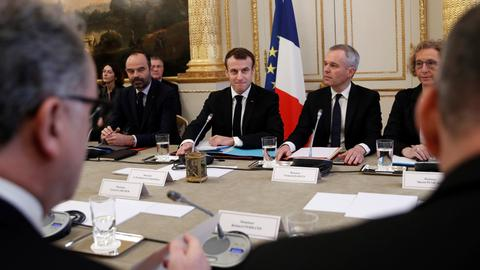 French President Macron meets union representatives after protests