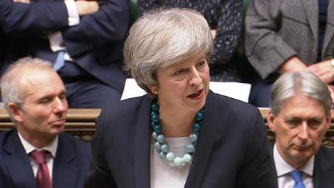 Brexit in turmoil as PM May delays vote on UK divorce deal