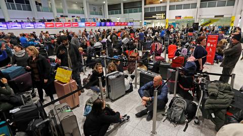 Travellers face days of delays as drones shut Gatwick airport down