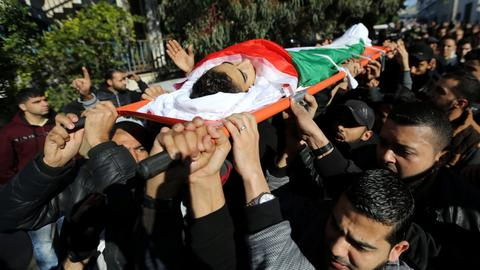Palestinians bury four killed in Gaza protests