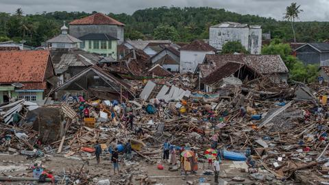 Race to find survivors, aid victims after Indonesia tsunami