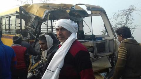 Truck collides with school bus in India killing at least 13 children