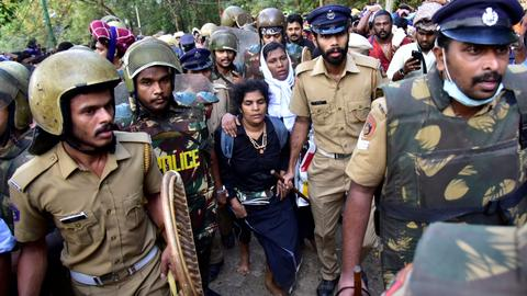 India arrests 750 as third woman enters flashpoint temple