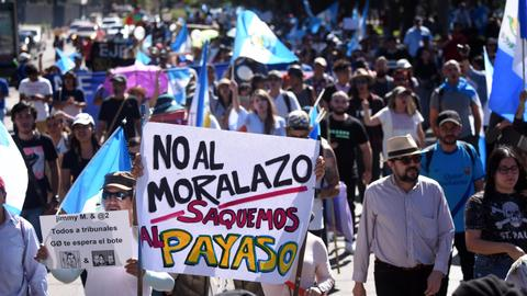Guatemalans march over president's bid to close UN anti-graft unit