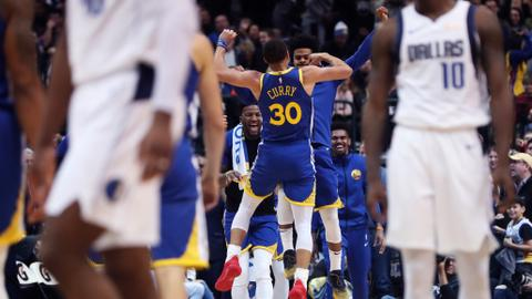 Curry drops 48 as Warriors escape Mavericks