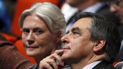 France's Fillon says he will contest election despite scandal