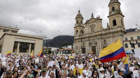 Thousands march in Bogota to protest terror after deadly car bombing