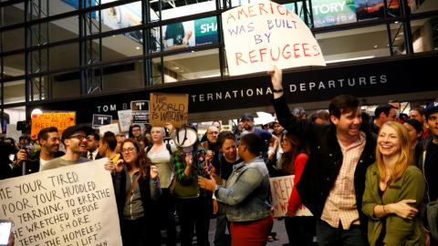 Trump's travel ban sparks legal reaction and international confusion