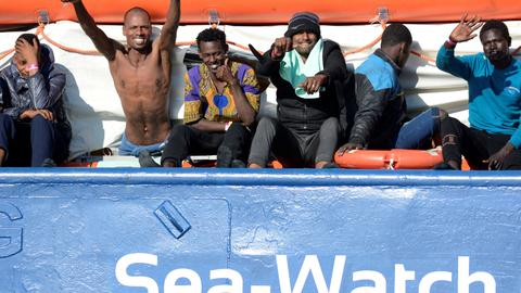 Rescued migrants to dock in Italy after deal reached – PM