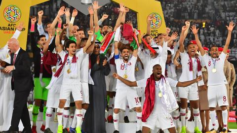 Football - Qatar beat Japan 3-1 to win Asian Cup for first time