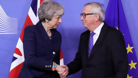 May vows to deliver on Brexit, EU tells UK no renegotiation