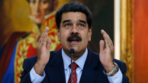 Maduro orders militia expansion as Guaido tours blackout-ravaged state