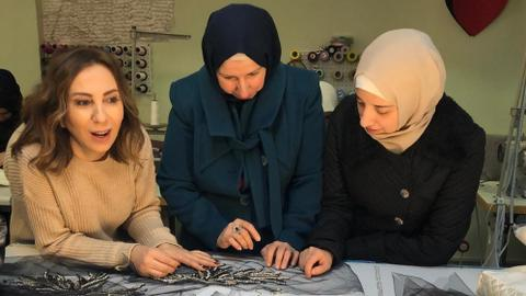 Zeynep Kartal showcases fabric made by Syrian refugee women