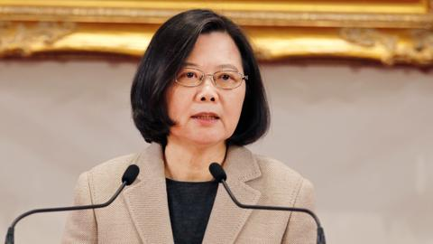 Taiwan says no compromise on democracy after opposition's China overture