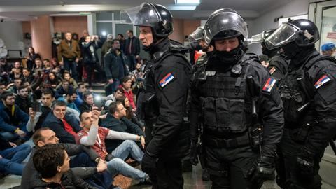 Serbia opposition supporters invade state-run TV