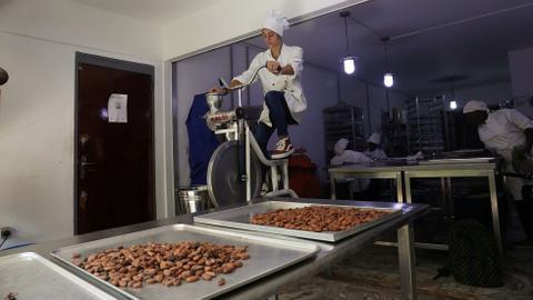 In Ivory Coast, organic chocolate made with a bicycle