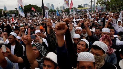 Protesters demand Jakarta governor's arrest ahead of runoff polls