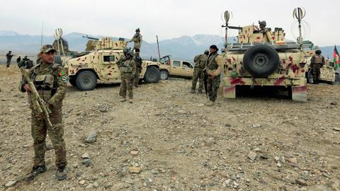 Taliban attacks on checkpoints kill eight - Afghan officials