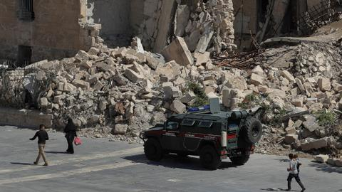 Suicide bombers attack Syrian regime forces post, several dead - media