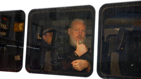 Julian Assange arrested by British police at Ecuadorian embassy