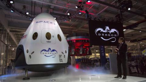 SpaceX to fly two tourists around moon next year