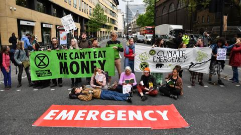 In pictures: Climate protesters block entrance to London Stock Exchange