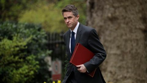 Why did British PM sack her defence secretary?