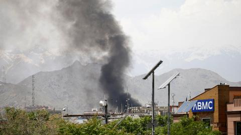 Large explosion and gunfire in Afghan capital, officials say