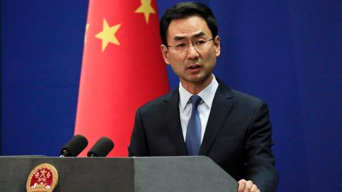 China says will never surrender to outside pressure amid US trade row