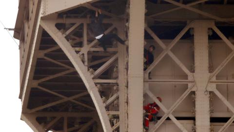 Eiffel Tower climber held by police after sparking evacuation