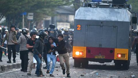Police arrests dozens amid post-election protests in Indonesia