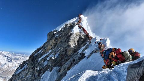 Mount Everest climb became 'death race'