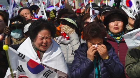 Protests rock S Korea after president removed from office