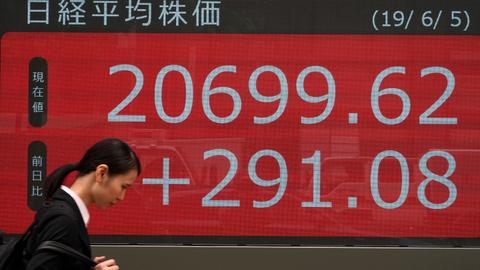 Asian shares jump on US Fed's rate cut bandwagon