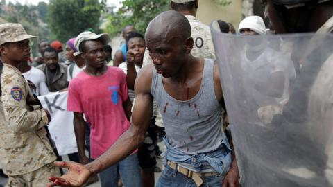 At least two killed as protesters take to the streets in Haiti
