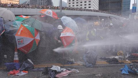 Hong Kong police tear gas protesters trying to storm parliament
