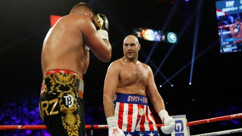 Tyson Fury stays unbeaten, battering Schwarz with second round knockout