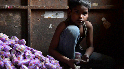 Indian police rescue child workers from biscuit factory
