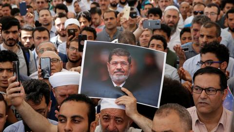 Special prayers held for Egypt's Morsi after restricted burial