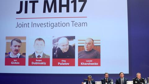 Four charged with murder over MH17 crash that killed almost 300