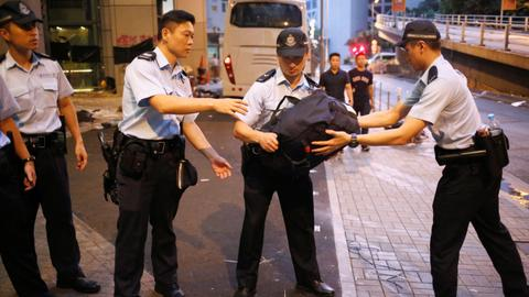 Hong Kong protesters disperse after blockading police headquarters