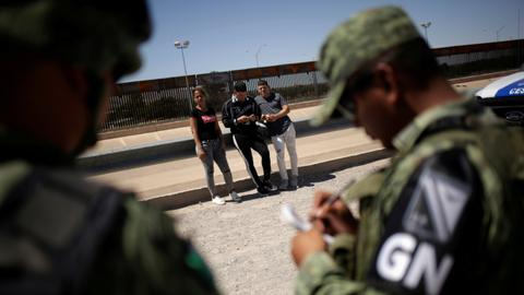 Mexico president says National Guard not instructed to detain migrants