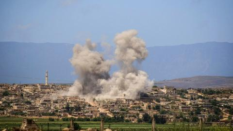 Nearly 100 dead in northwest Syria fighting - monitor