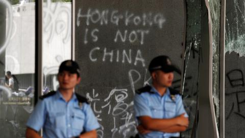 China denounces Hong Kong protests as 'undisguised challenge' to its rule