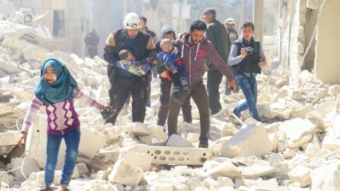 US-led air strikes kill dozens in Syria