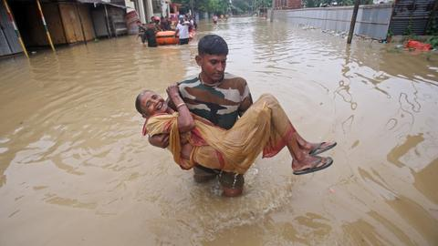 At least 14 dead in India as monsoon batters South Asia