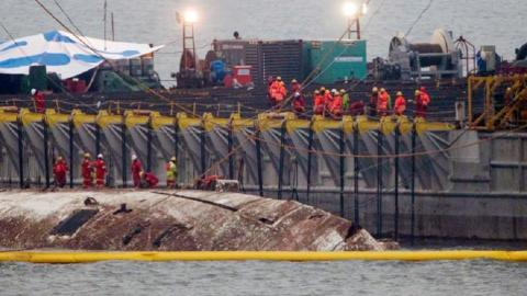 South Korea raises sunken ferry three years after catastrophe