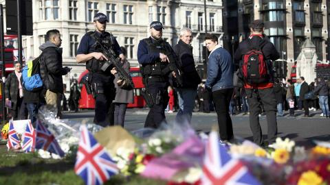 Police widen probe in London's car and knife attack