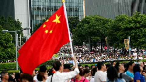 Pro-police rally draws thousands in polarised Hong Kong