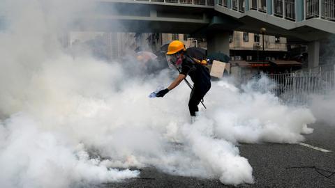 Hong Kong police fire tear gas at 'anti-triad' rally